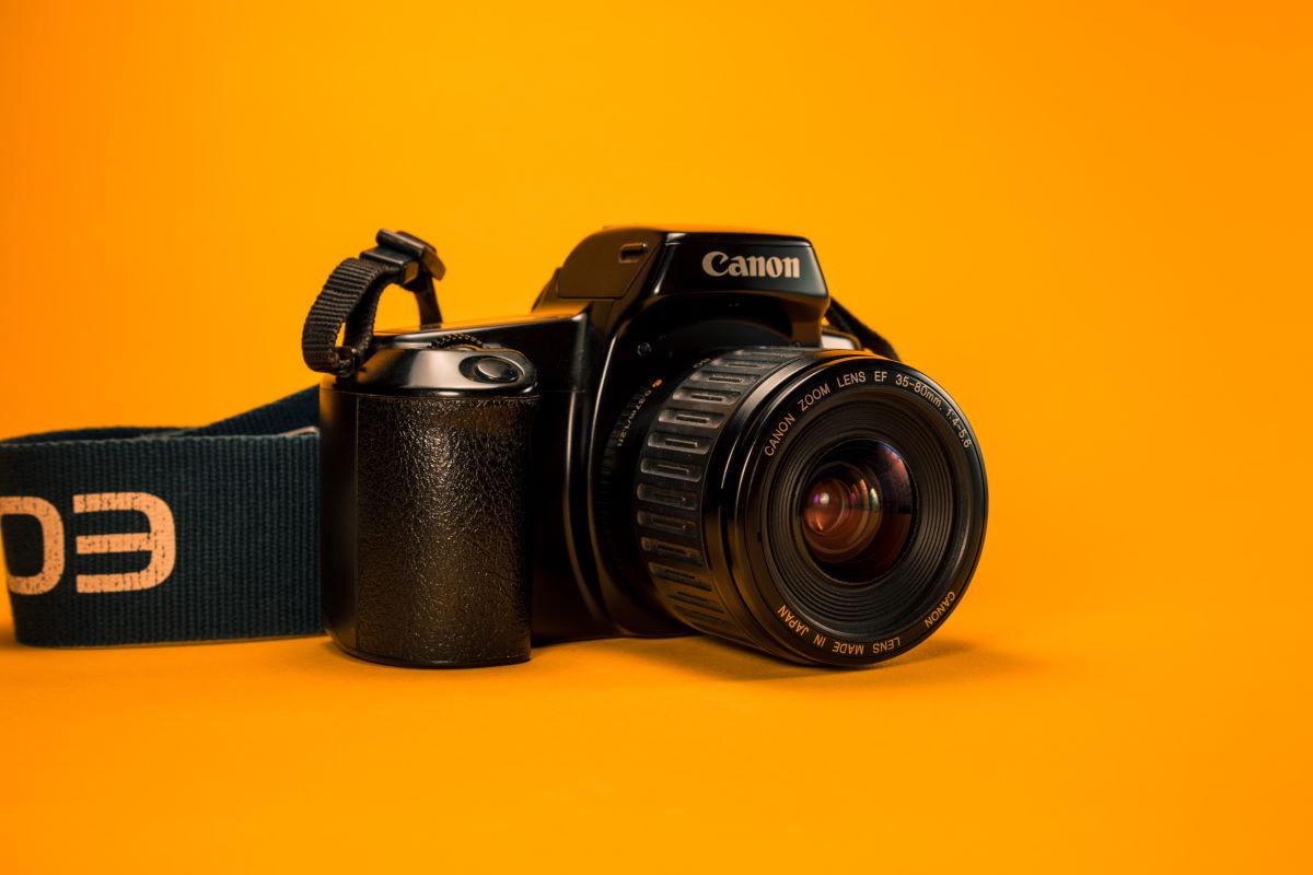 Câmera representando os Versículos para foto